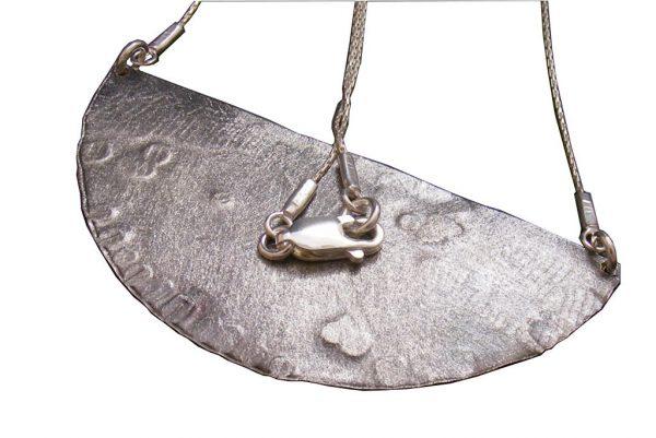 Silver-Half-Circle-Necklace-Reborn-2-Backside-NECKLACE-Reborn2-6x3-silver-RWP-1019tryfirst0319rsz.jpg