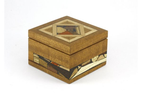 Small wooden jewelry box with rich multi wood mosaics. No stains or dyes.